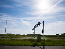 Traffic lights on parallel roads against a blue sky Stock Images