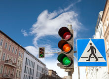 Traffic lights and pedestrian crossing sign in a city Royalty Free Stock Images