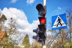 Traffic lights and pedestrian crossing sign in a city Stock Images