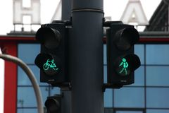 Traffic lights for pedestrians and cyclists on the background of a modern building. convenient city with good infrastructure for stock photo