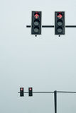 Traffic lights on a pole, straight and turn right direction. Traffic lights on a pole (red), straight and turn right direction Stock Photos