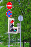 Traffic lights and prohibitory signs. At the traffic light, red and green arrow are on, `stop` signs and the stop is forbidden are on top Stock Image