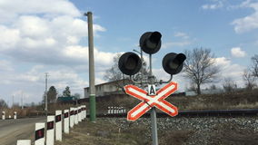 Traffic lights at a railway crossing. The Traffic lights at a railway crossing stock footage