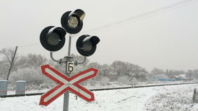 Traffic lights at a railway crossing in winter. The  Traffic lights at a railway crossing in winter stock video