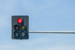 Traffic lights on red against blue sky background. Red traffic lights on red against blue sky background Stock Photo