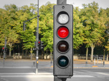 Traffic lights red. Traffic lights with a red color on the background of the road Stock Image