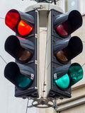 Traffic lights with red and green light. A traffic light with red and green light at an intersection stock photos