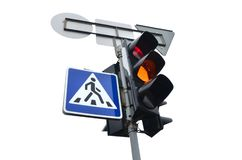 Traffic lights with the red light lit isolated on white. Optical device that supplies light signals that regulate the movement of road transport royalty free stock photo