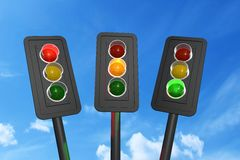 Traffic lights red, yellow and green 3d render. Traffic lights red, yellow and green over sky background 3D rendering Royalty Free Stock Images