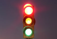 Traffic lights with red, yellow and green lights. Night shot Stock Photography