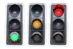 Traffic lights showing red green and red isolated. On white concepts for go and stopp and structure chaos Royalty Free Stock Photography