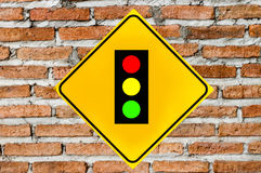 Traffic lights sign on brick wall Stock Photos
