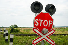 Traffic lights and signs at the railroad crossing Royalty Free Stock Photos