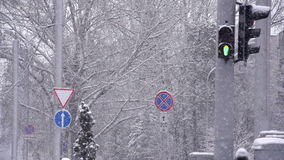 Traffic Lights and Snow. Urban winter landscape. Pedestrian traffic lights working during heavy snowfall. Slow Motion at a rate of 240 fps stock footage