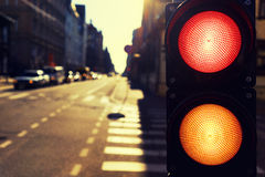 Traffic lights in the street at night in the spring at sunset Stock Photography