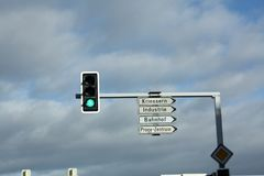 Traffic lights with street signs in Switzerland. Green Royalty Free Stock Image