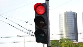 Traffic lights on street turning blinking. From red stop to green go semaphore stock video footage