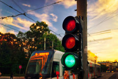 Traffic lights and a tram in counter light Stock Photo