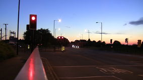 Traffic lights and transport at night stock video footage