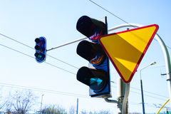Traffic lights and yield sign on sky background. Royalty Free Stock Photography