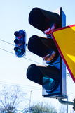Traffic lights and yield sign on sky background. Stock Image