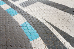 Traffic Line. White and blue Traffic Line On Concrete paving block royalty free stock image