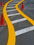 Traffic Lines. Freshly painted traffic lines and cones on an empty road Stock Photos