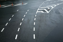 Traffic lines on asphalt Stock Images