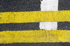 Traffic lines on the asphalt road surface is composed of one type of background. Royalty Free Stock Photo