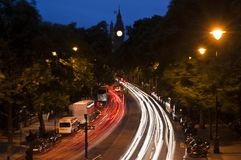Traffic in London, light streaks at dusk. Big Ben tower with English flag on the background Stock Images