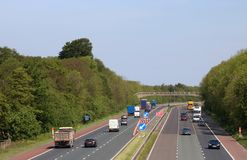 Traffic on M6 motorway in countryside, Lancashire. Looking north along the southbound carriageway of the M6 motorway in the countryside near Scorton in stock image