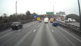 Traffic on the M25 from truck driver`s perspective stock footage