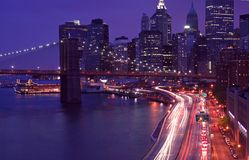 Traffic in Manhattan. With city skyline in the background Stock Images