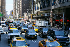 Traffic in Manhattan. New York City, USA - May 19, 2014: Many cars driving through a congested street in midtown manhattan. It's the 8th Avenue with six lanes Royalty Free Stock Photography