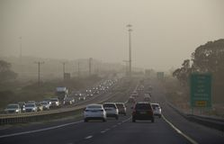 Traffic during Massive Middle East sand storm in Israel Highway. Highway in Israel during Sand Storm. Israel Officials warned residents to stay indoors Royalty Free Stock Photo