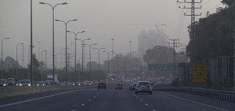 Traffic during Massive Middle East sand storm in Israel Highway. Highway in Israel during Sand Storm. Israel Officials warned residents to stay indoors.Panorama Stock Photo
