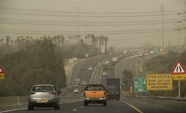 Traffic during Massive Middle East Sandstorm in Israel . Low Vis. Netanya, Israel - March 08, 2018: Traffic in Highway num.2 in Center of Israel during Massive Royalty Free Stock Image