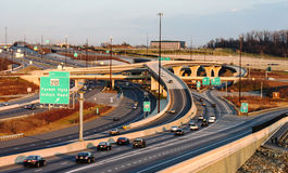 Traffic Metropolitan Interstate Interchange DC. Vehicular traffic moving along and through complicated and confusing cloverleaf interchanges along interstate I95 Stock Image