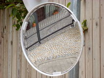 Traffic Mirror. Photo of a traffic mirror next to a wooden fence royalty free stock image