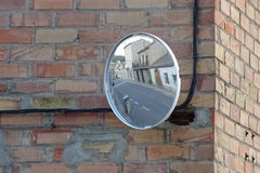 Traffic mirror with street reflection royalty free stock photo