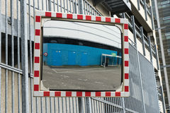 Traffic mirror to see around the corner for safety. Traffic mirror to see carts coming from around the corner for safety Stock Image