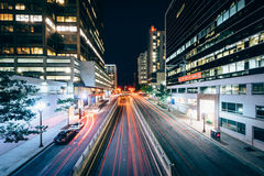 Traffic and modern buildings along Fort Myer Drive at night, in royalty free stock photography