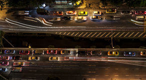 Traffic in modern city at night, Sathorn Rd. Bangkok Thailand. Royalty Free Stock Images