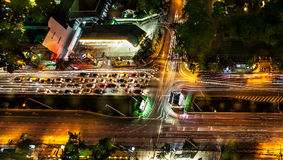 Traffic in modern city at night, Sathorn Rd. Bangkok Thailand Stock Image