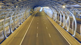 Traffic in modern tunnel. Timelapse, zoom in stock video footage