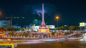 Traffic monument timelapse. Timelapse of traffic intersection at Victory Monument with storm cloud formation in Bangkok,Thailand stock video footage