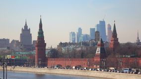 Traffic on Moscow Kremlin embankment and distant business center 'Moscow city' stock video