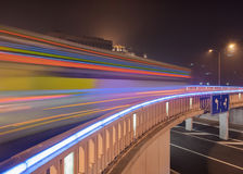 Traffic in motion blur on illuminated bridge, Beijing night-time, China Royalty Free Stock Images