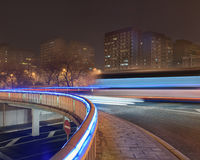 Traffic in motion blur on illuminated bridge, Beijing night-time, China Stock Image