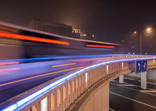 Traffic in motion blur on illuminated bridge, Beijing night-time, China Royalty Free Stock Photo